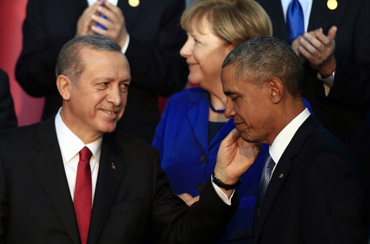 """President Barack Obama, right, is greeted by Turkish President Recep Tayyip Erdogan as German Chancellor Angela Merkel is seen in background, after posing for a family photo at the G-20 summit in Antalya, Turkey, Sunday, Nov. 15, 2015. U.S. President Barack Obama pledged Sunday to redouble U.S. efforts to eliminate the Islamic State group and end the Syrian civil war that has fueled its rise, denouncing the extremist group's horrifying terror spree in Paris as """"an attack on the civilized world."""" (AP Photo/Lefteris Pitarakis)"""