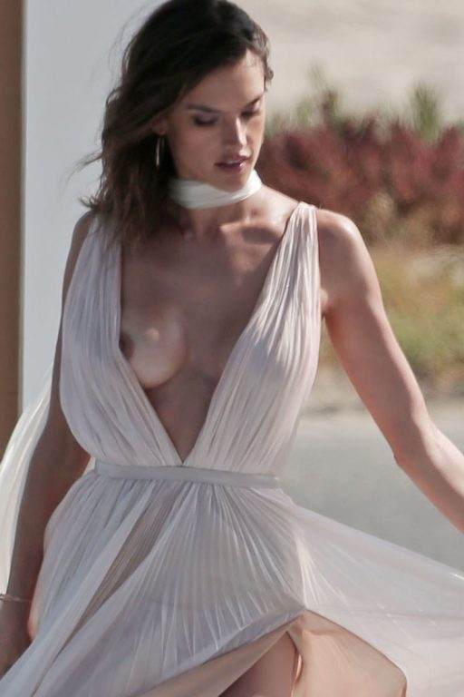 CONTAINS NUDITY Alessandra Ambrosia experiences several wardrobe malfunctions during a secret photo shoot on the beach