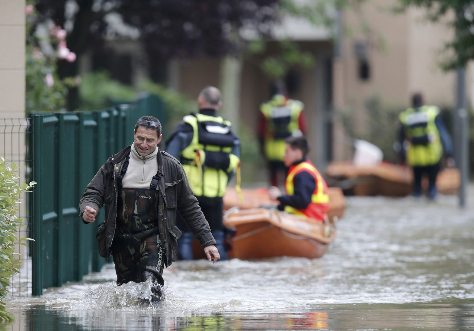 A man walks through a flooded area in Longjumeau, southern Paris, after days of almost non-stop rain caused flooding in the country, June 2, 2016. REUTERS/Christian Hartmann