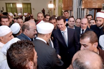 """A picture released by Syria's official news agency SANA shows Syrian President Bashar al-Assad (C) greeting religious figures after the morning prayer of the Muslim holiday of Eid al-Adha at the Al-Adel mosque  in Damascus on September 24, 2015, in a rare public appearance for the embattled regime head. Assad attended the prayer of the Muslilm holiday of sacrifice along with state and ruling Baath party officials as well as a number of Muslim religious leaders and civilians, Syria's official news agency SANA reported. AFP PHOTO / HO / SANA == RESTRICTED TO EDITORIAL USE - MANDATORY CREDIT """"AFP PHOTO / HO / SANA"""" - NO MARKETING NO ADVERTISING CAMPAIGNS - DISTRIBUTED AS A SERVICE TO CLIENTS =="""