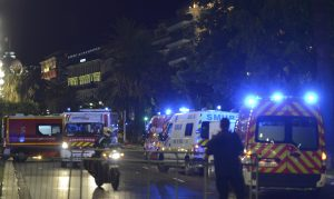 French police and rescue forces vehicles are seen on the Promenade des Anglais July 15, 2016 after at least 60 people were killed in Nice, France, when a truck ran into a crowd celebrating the Bastille Day national holiday July 14.  REUTERS/Jean-Pierre Amet