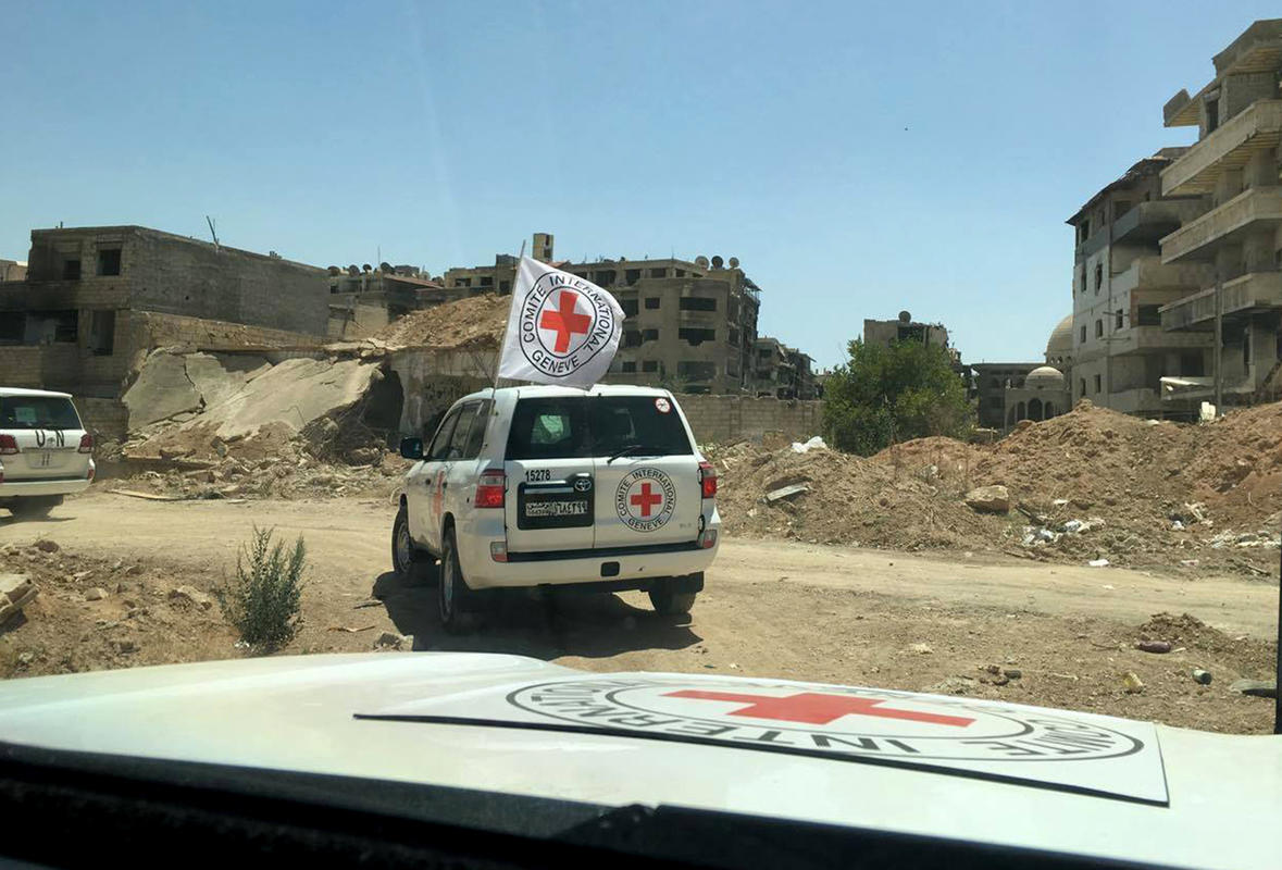 FILE -- In this Wednesday, June 1, 2016, file photo released by the International Committee for the Red Cross, shows the first humanitarian aid convoy in Daraya, Syria. The Syrian Arab Red Crescent and the United Nations have delivered food aid to the Damascus suburb of Daraya for the first time since it came under siege in 2012, hours after the U.N. said the Syrian government had approved access to 15 of the 19 besieged areas within Syria. (ICRC via AP, File)