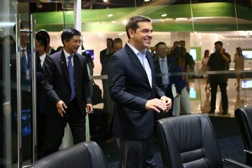 epa05404924 Greek Prime Minister Alexis Tsipras visits Huawei's Beijing Exhibition Center in Beijing city, China, 03 July 2016. Greek PM Alexis Tsipras is on an official visit and is expected to meet with Chinese counterparts to boost bilateral ties.  EPA/WU HONG