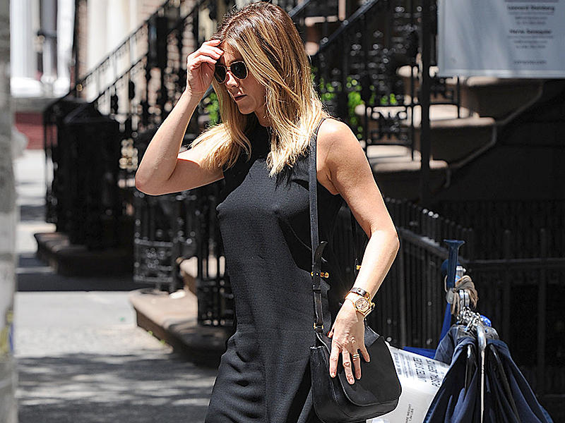 Jennifer Aniston leaves her apartment in a nice black dress in New York City. Pictured: Jennifer Aniston Ref: SPL1311071 300616 Picture by: Jason Winslow / Splash News Splash News and Pictures Los Angeles:310-821-2666 New York:212-619-2666 London:870-934-2666 photodesk@splashnews.com