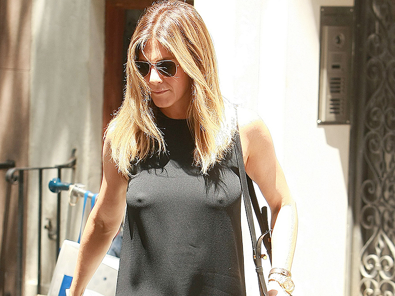 New York, NY - New York, NY - Jennifer Aniston opts for no bra while out in the big apple as she is seen looking chic in a sleeveless black dress and matching heels. AKM-GSI 30 JUNE 2016 To License These Photos, Please Contact : Maria Buda (917) 242-1505 mbuda@akmgsi.com or Mark Satter (317) 691-9592 msatter@akmgsi.com sales@akmgsi.com