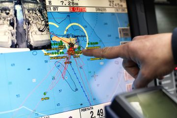 FRONTEX agency operation 'Hermes': An italian Coast Guard crew member indicates the island of Lampedusa on a radar inside a patrol vessel docked in the port of Lampedusa