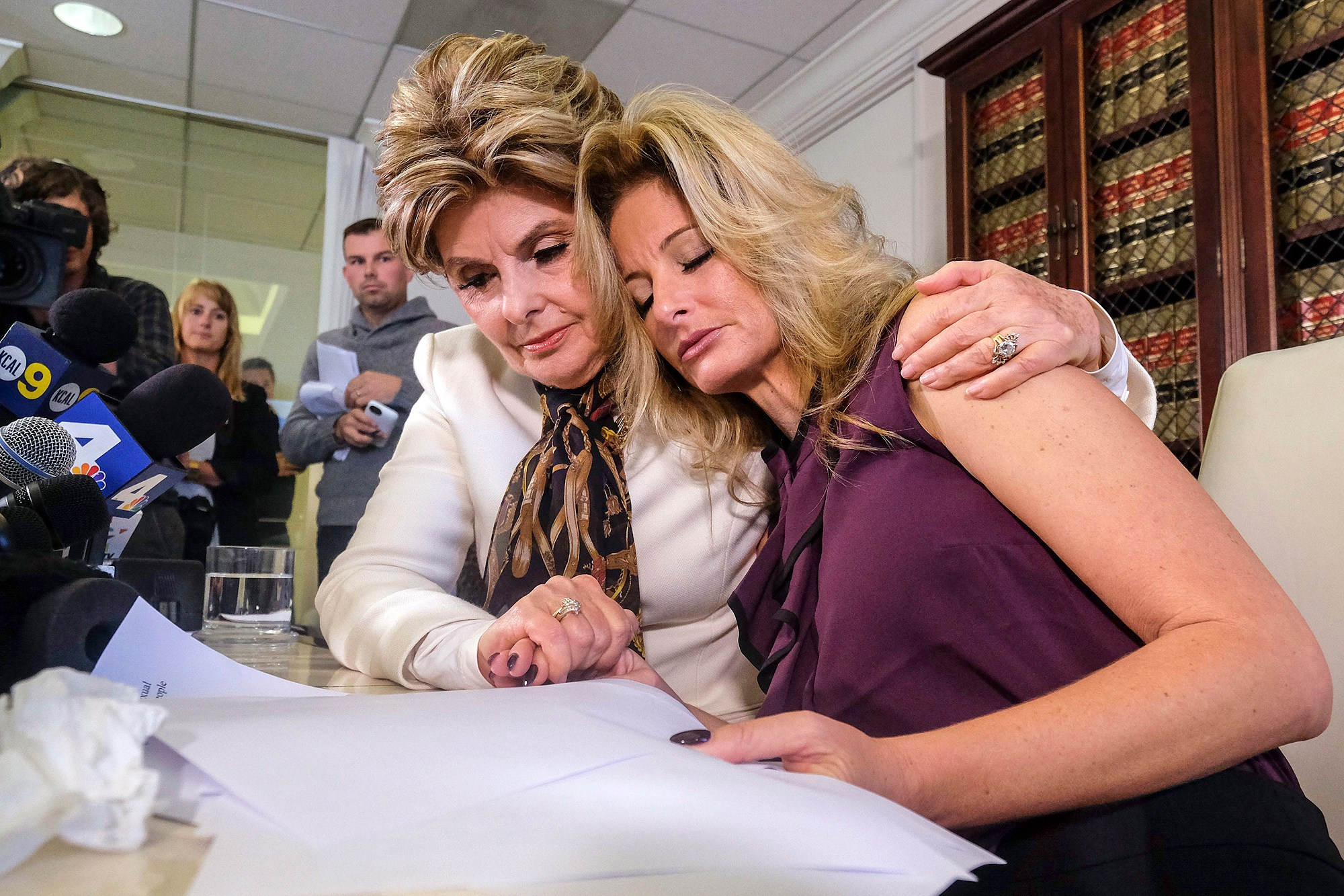 "Attorney Gloria Allred, left, comforts Summer Zervos during a news conference in Los Angeles, Friday Oct. 14, 2016. Zervos, a former contestant on ""The Apprentice"" says Republican presidential candidate Donald Trump made unwanted sexual contact with her at a Beverly Hills hotel in 2007. Zervos is among several women who have made sexual allegations against the Republican nominee. He has strenuously denied them. (AP Photo/Ringo H.W. Chiu)"