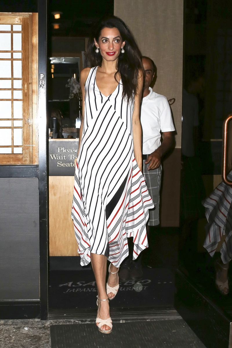 Studio City, CA - George Clooney and wife Amal have a quiet dinner date at Asanebo Sushi with a friend for to bring in the weekend.  Amal looked gorgeos in a striped maxi dress with wedge heels and appeared to be amused from the flashing cameras. AKM-GSI    September 25, 2015 To License These Photos, Please Contact : Steve Ginsburg (310) 505-8447 (323) 423-9397 steve@akmgsi.com sales@akmgsi.com or Maria Buda (917) 242-1505 mbuda@akmgsi.com ginsburgspalyinc@gmail.com
