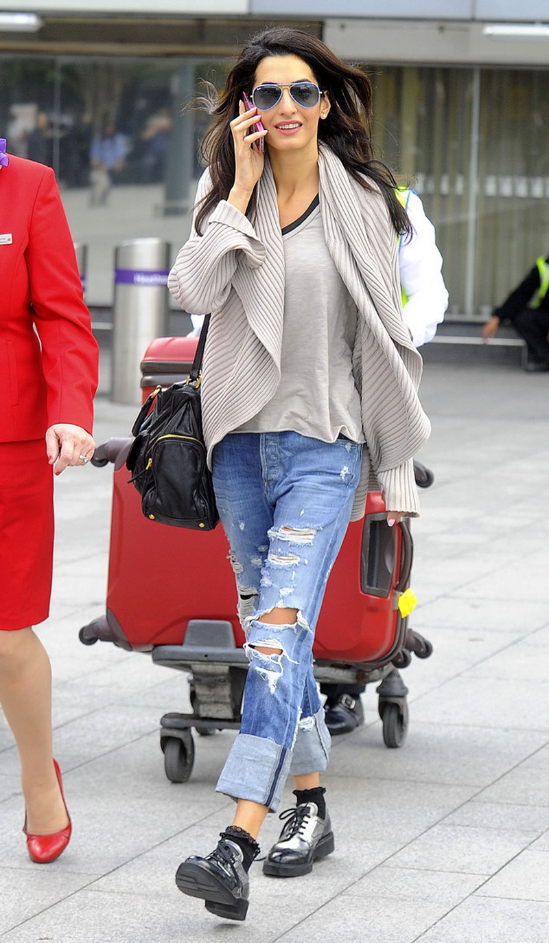 George Clooney's fiance, Amal Alamuddin arrives at Heathrow Airport in London. She was pictured wearing her 450,000 pound ring. Pictured: Amal Alamuddin Ref: SPL755976  130514   Picture by: Splash News Splash News and Pictures Los Angeles:310-821-2666 New York:212-619-2666 London:870-934-2666 photodesk@splashnews.com