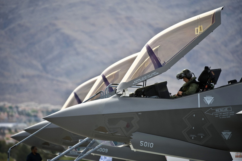 U.S. Air Force Capt. Brad Matherne, 422nd Test and Evaluation Squadron pilot, conducts pre-flight checks inside an F-35A Lightning II before a training mission April 4, 2013, at Nellis Air Force Base, Nev. The F-35A will be integrated into advanced training programs such as the USAF Weapons School, Red Flag and Green Flag exercises. (U.S. Air Force photo/Senior Airman Brett Clashman)