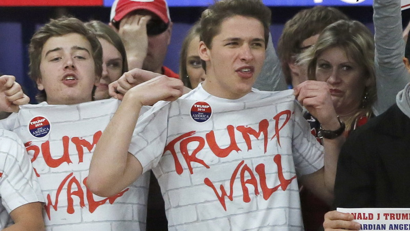 """FILE - In this Saturday, April 2, 2016 file photo, supporters of Republican presidential candidate Donald Trump chant, """"Build that wall,"""" before a town hall meeting in Rothschild, Wis. (AP Photo/Charles Rex Arbogast, File)"""