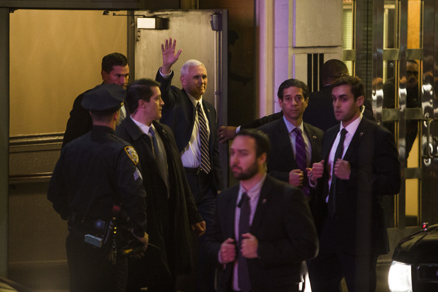 "Vice President-elect Mike Pence, top center, leaves the Richard Rodgers Theatre after a performance of ""Hamilton,"" in New York, Friday, Nov. 18, 2016. (AP Photo/Andres Kudacki)"